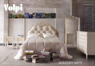 Двухспальтная кровать с резным изголовьем в ткани капитоне Romeo